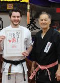 Sempai Alex Lloyd is awarded his 2nd Dan in Kobudo by Sensei Hokama, January 2017.