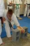 Sempai James Campbell performs tameshiwari (board breaking) with shuto (knife hand).