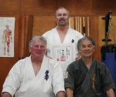 Sensei Paul Finnerty is awarded his 2nd Dan in Kobudo by Sensei Hokama and Shihan Lipman, September 2012