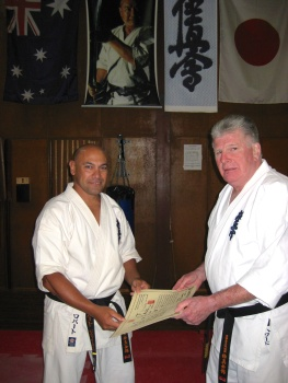 Sempai Rob James receives his official dojo operator license from Shihan Howard Lipman in 2013.