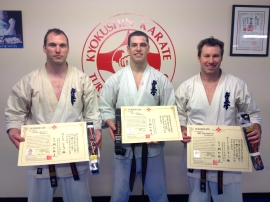 Sensei James Sidwell (4th Dan), Sempai Sammy Vieira (1st Dan) and Sensei Mark Shelmerdine (4th Dan) with their new belts & certificates.