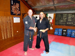 Shihan Cunningham awards Sempai Rob his 8th Kyu in Kobudo.
