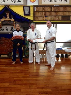 Sensei Mark McFadden is awarded his 2nd Dan in Kobudo by Sensei Hokama and Shihan Lipman