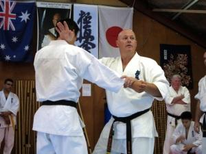 Shihan Rick Cunningham demonstrates bunkai on Sempai Don Cheong