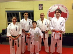 Little Lion kata champion Ruben with Sempai Rob and judges.