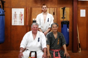 James receives his Shodan in Kobudo from Shihan Lipman and Sensei Hokama, September 2012