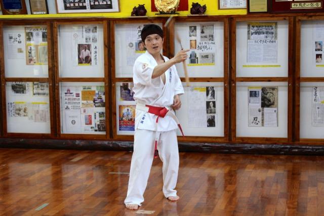 Shihan Ken Ogura with nunchaku.
