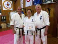 Patricia Tan receiving her 4th Kyu Kobudo certificate.