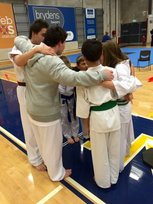 The boys huddle before the fights.