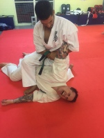 Jermaine performing a self-defence technique.