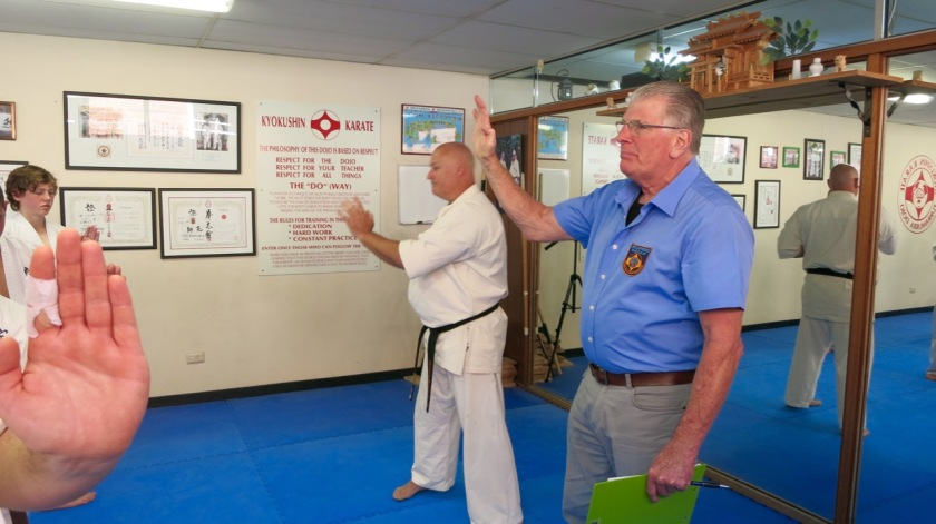 Shihan Howard Lipman corrects technique of students while assessing them.