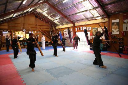 The class perform the Eeku kata.