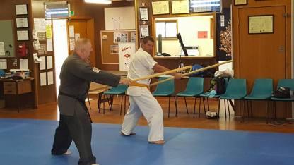 Sensei Paul teaching Mick the Bo.