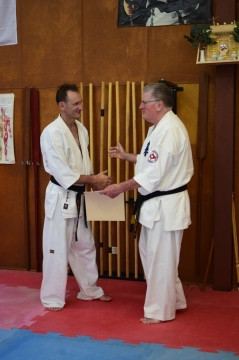 Shihan Howard Lipman awards Shihan Peter Olive his 5th Dan in Kyokushin.