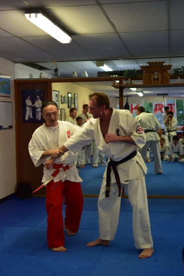 Shihan Ken Ogura demonstrates on Sensei Peter Olive