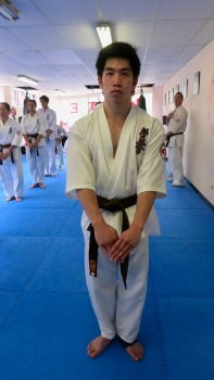 "Jonathan observing ""Mokuso"" before a senior kata."