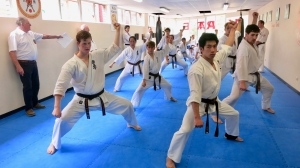Sempai Jonathan and others performing kata in his Shodan grading.