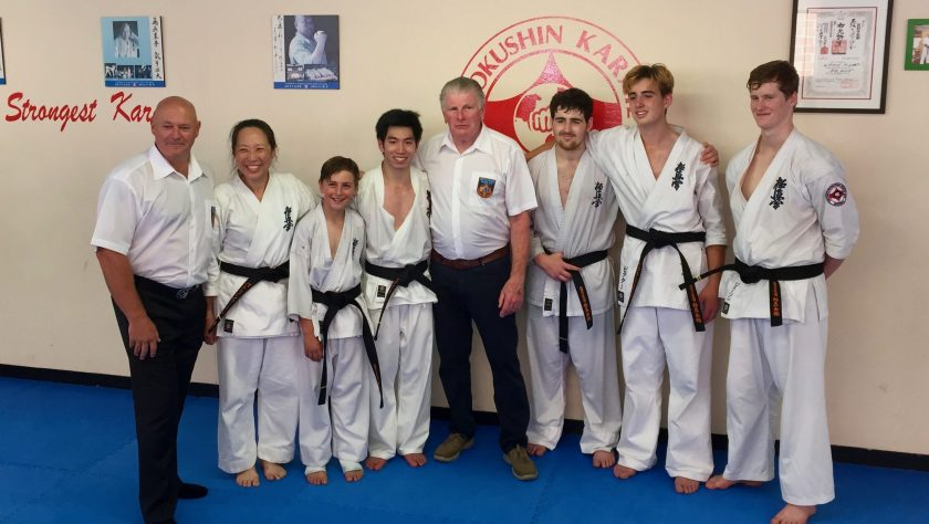 Shihan Howard Lipman and Shihan Rick Cunningham with the new black belts.