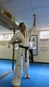 Shihan Peter Olive leads the grading.