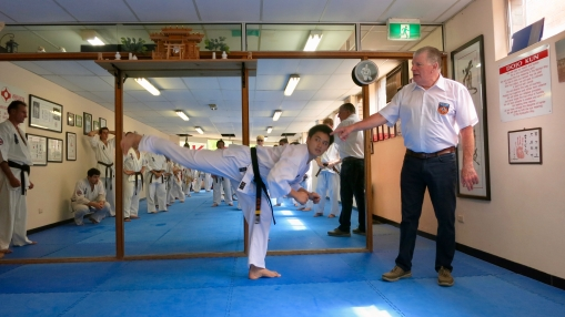 Shihan Howard corrects students' technique.