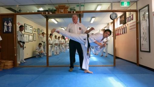 Sensei Ben Ng demonstrates Ushiro Geri.