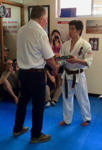 Shihan Howard Lipman awards Sempai Jonathan Lee his Shodan, December 2016.