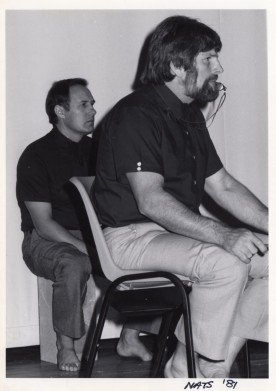 Shihan Howard Lipman (right) referees while Shihan Bob Boulton (left) watches on