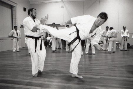 Shihan Howard demonstrates a reverse kick on Shihan Rick