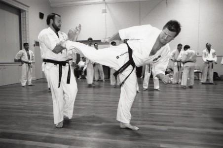 Shihan Howard demonstrates a reverse kick on Shihan Rick