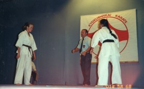 Shihan Rick Cunningham referees a tournament
