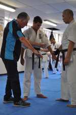 Hanshi Lipman instructing Ben Brady and Tony Kuo in Tsukue Uke Bunkai