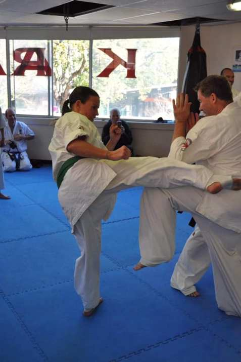 Larissa Watson strikes Sensei Mark Shelmerdine with chudan mawashi geri